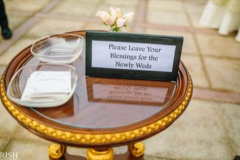 Photo of Guests leave advice and blessings for the couple