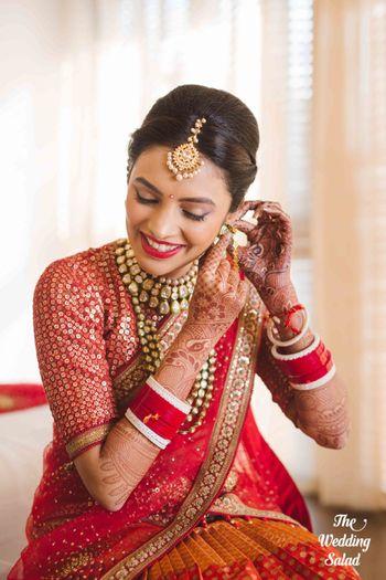 Bride getting ready shot wearing earrings