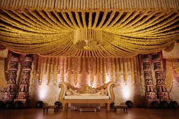 A grand Kalyan mandapam decor with yellow & white flowers