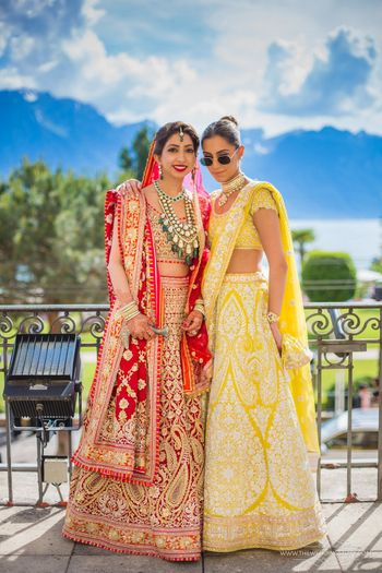 Bride with sister in gorgeous outfits