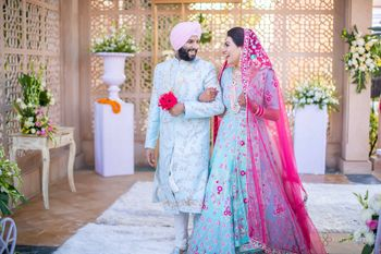 matching bride and groom in powder blue outfits