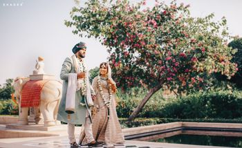 Photo of A color-coordinated couple pose ahead of their Anand Karaj ceremony