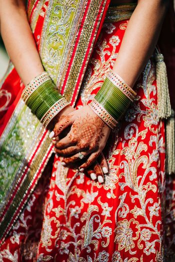 Photo of beautiful detailed shot of bridal chooda