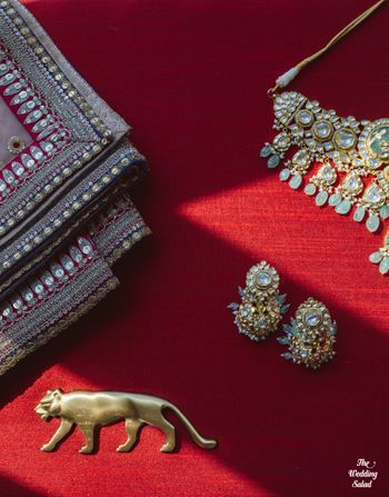 Photo of bridal jewellery and sabyasachi box getting ready shot idea