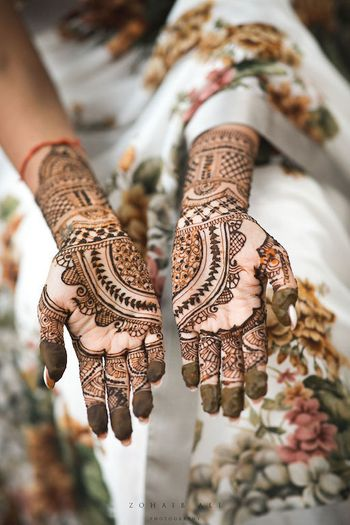 Minimal bridal mehendi design half and half