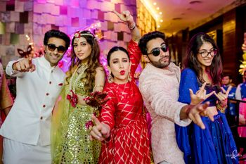 A dancing family portrait on mehendi day with karishma kapoor