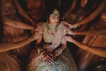 Unique bridal portrait idea with bridesmaids
