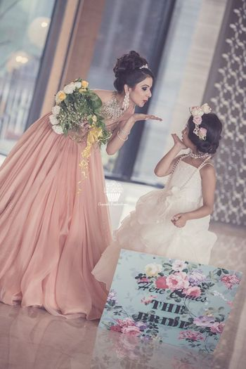 indian bride with neice blowing kiss