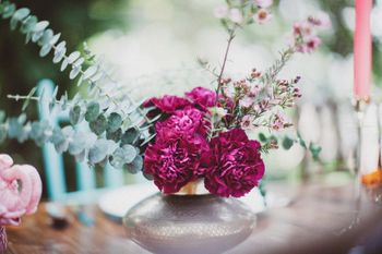Photo of Purple rose and sage centerpieces