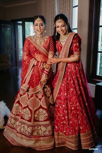 Photo of Sister of the bride in a red lehenga