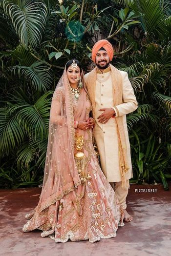 Photo of Sikh couple shot with matching turban and lehenga
