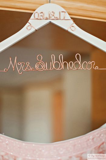 Photo of Personalised bridal hanger with brides new name