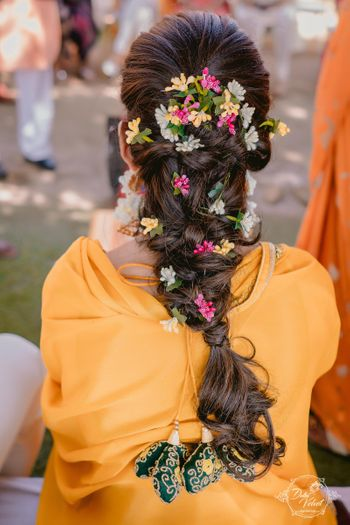 A beautiful braid decorated with little flowers.