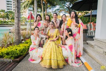 Photo of Bride and bridesmaids in a candid fun shot