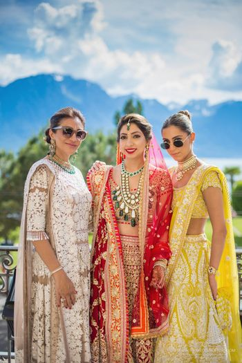 Photo of Bride with stylish mom and sister