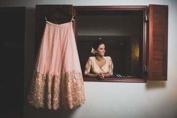 Photo of Bride with lehenga getting ready shot