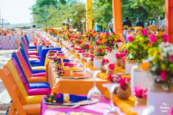 Photo of colourful mehendi decor idea with pickle jars as centrepieces