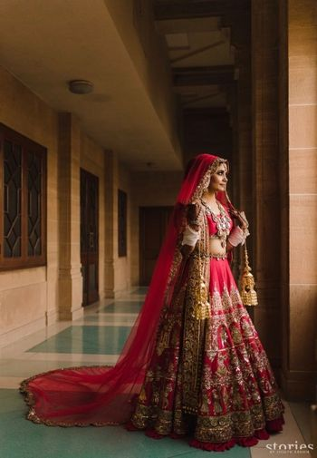 Red manish malhotra lehenga with a train dupatta