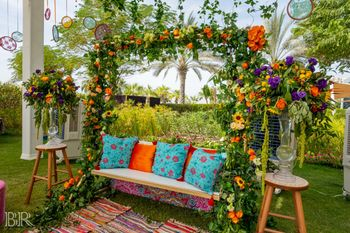 Mehendi decor with cushions on swing