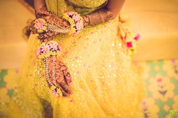 Photo of Mehendi hands with yellow and pink haathphool