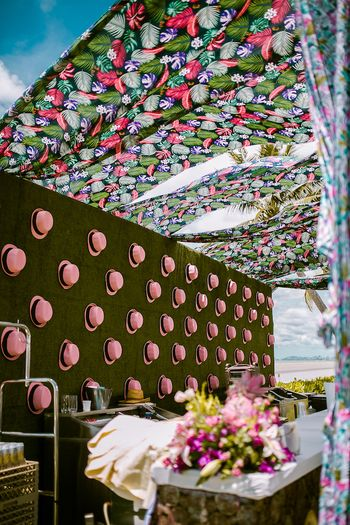 Photo of Floral tent with hat backdrop for mehendi