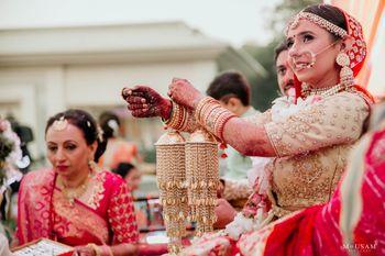bride showing off her unique gold bridal kaleere