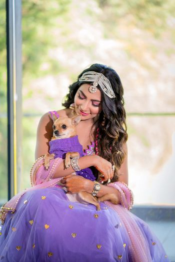 Photo of Cute bride with her dog for mehendi