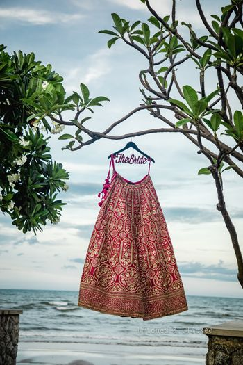 Red hanging lehenga shot