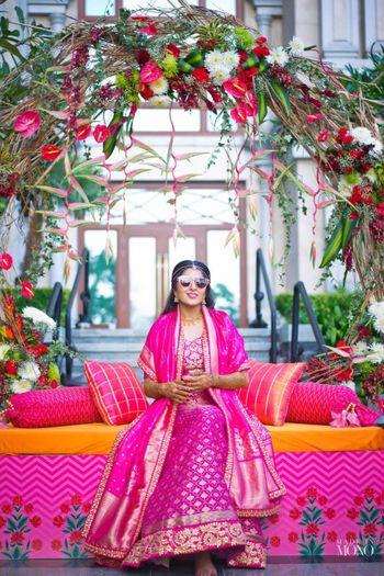 Bright pink benarasi lehenga with unique drape dupatta