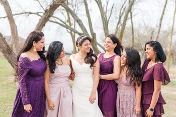 Bride with matching bridesmaids in purple