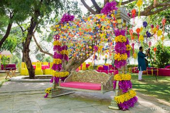 Photo of Quirky mehendi swing for bride with paper decor