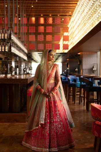 Photo of Red and green anita dongre bridal lehenga