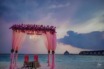 simple pink mandap idea by the beach
