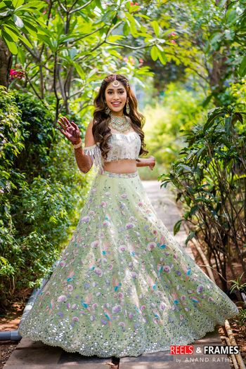 Bridal mehendi look in cold shoulder blouse and light green lehenga