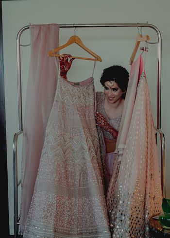 A bride posing with her pink pastel lehenga!