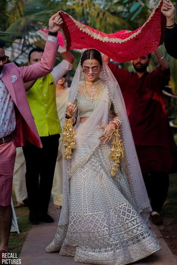 Falguni and Shane pastel bridal lehenga