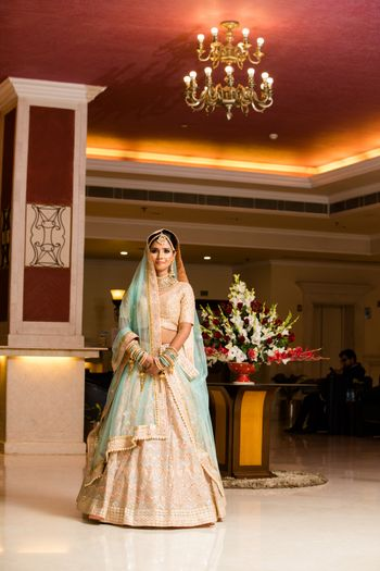 Pastel bride in light blue and peach lehenga