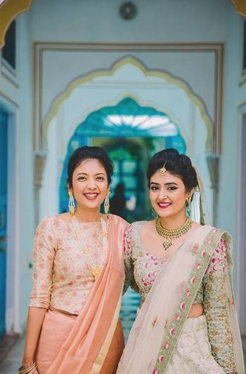 Bride with sister in offbeat lehenga