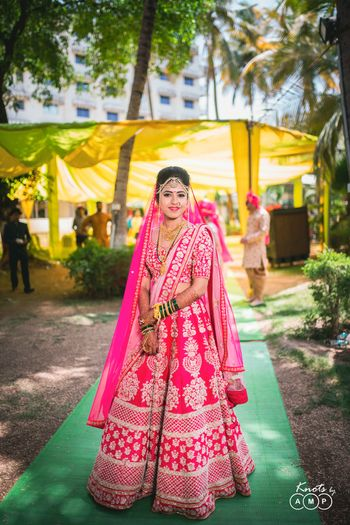 Photo of Bride in red lehenga for north indian wedding
