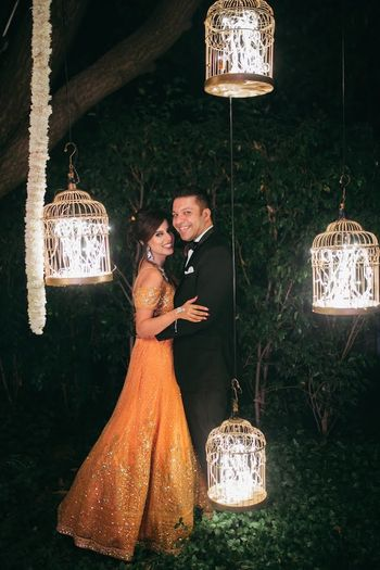 Couple portrait on reception with birdcage decor