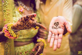 Groom mehendi design with brides name