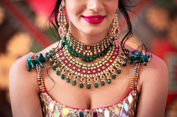 Photo of A shot of a bride wearing stunning layered jewellery.