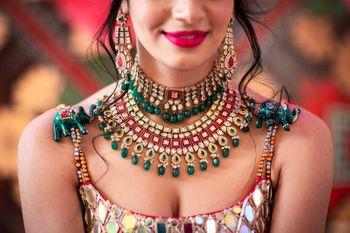 A shot of a bride wearing stunning layered jewellery.