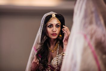 Bridal portrait looking in mirror