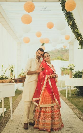 Photo of Red and orange bridal lehenga by Anita Dongre