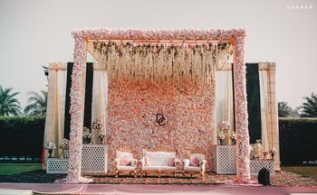 Photo of Artistic floral stage decor for the bride and groom.