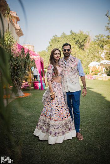 Photo of Twinning mehendi bride and groom look