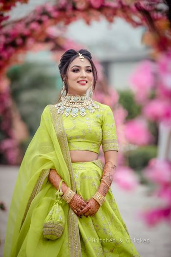 Photo of Light green sabya lehenga for mehendi with pastel jewellery