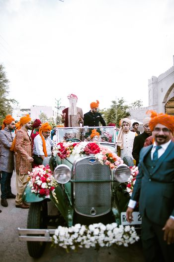 Groom entering in a vintage car for destination wedding