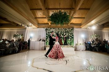 Couple dancing on unique dance floor with monograms
